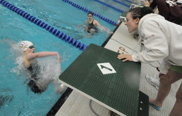 Senior Chelsea Oldfield (right) cheers on Foxcroft Academy teammate Blake Dyer in heat five of the girls 200-yard IM during the 34th annual PVC Swimming and Diving Championships at Husson University on Saturday, Feb. 11, 2012.