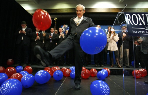 Republican presidential candidate Rep. Ron Paul, R-Texas, kicks balloons from the stage after speaking to supporters following his loss in the Maine caucus to Mitt Romney on Saturday, Feb. 11, 2012, in Portland.