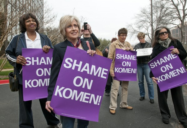 A small group of women protest outside the Susan G. Komen for the Cure headquarters in Dallas, Tuesday, Feb 7, 2012. MoveOn.org delivered a petition with 832,000 signatures.