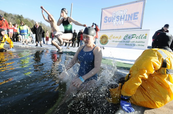 Dan Guerette (from left) of Bangor, Erin Frank of Orland and Deanna Wade of Bradley were the first brave souls to jump into the icy  depths of Phillips Lake for the annual Camp CaPella Polar Plunge in Dedham Sunday afternoon, Feb. 5, 2012.