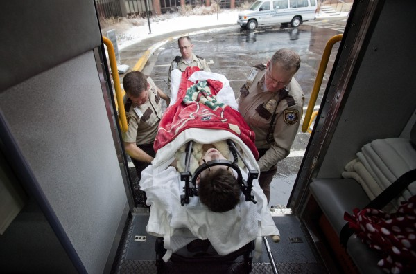 Jack Jablonski, 16, is taken off an ambulance after he was transferred from Hennepin County Medical Center to the Sister Kenny Rehabilitation Institute in Minneapolis, Minn. on Monday, Jan. 23, 2012. Jablonski suffered a spinal cord injury and was paralyzed after being checked from behind and crashing into the boards head first. The injury happened during a junior varsity hockey game between Benilde-St. Margaret's High School and Wayzata High School on Dec. 30.