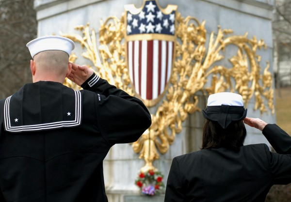 LS2 Job Johnson (left) and AEAA Janet Keith, Bangor Navy Operational Support Center, salute the U.S.S. Maine memorial during the playing of Taps at the 114th anniversary tribute in memory of the sinking of the battleship in Havana Harbor, Cuba, on February 15, 1898.
