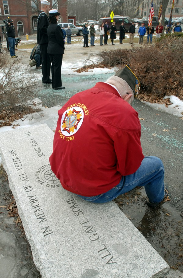 Navy veteran Dwight Cressy sits on a veterans memorial bench in Davenport Park on Wednesday and listens to the ceremony at the 114th anniversary tribute in memory of the sinking of the battleship U.S.S. Maine in Havana Harbor, Cuba, on February 15, 1898.