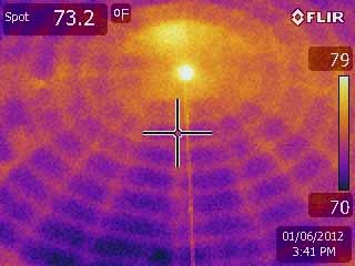 Rockland taxpayers are expected to save at least $11,000 in energy costs following a weatherization project at the public library. Infrared images from the Rockland Public Library (with matched regular photos) show temperature differences before the weatherization was done. Warmer objects emit more infrared radiation and appear yellow; cooler objects appear pink to purple to even black. The yellow lines indicate that wood framing holds more heat than the empty (purple) wall cavities do. The windows appear dark purple because they offer almost no insulating value and are coldest.