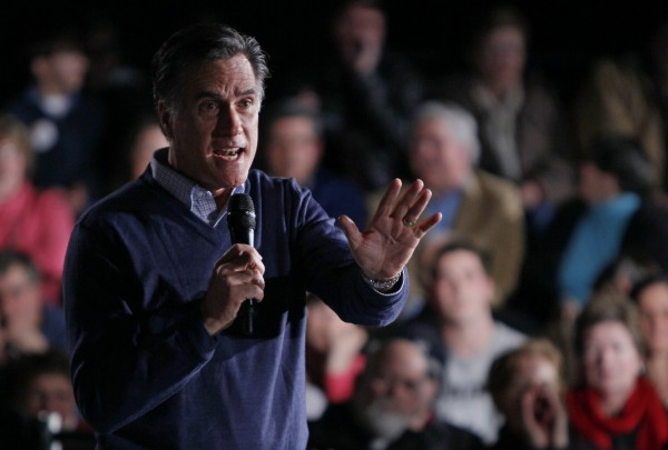 Republican presidential candidate Mitt Romney responds to a heckler during a campaign stop Friday, Feb. 10, 2012, in Portland, Maine.