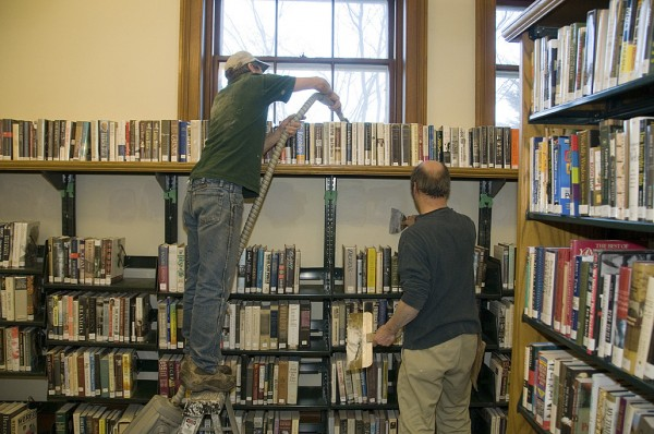 Evergreen Production Manager Svea Tullberg supervised work at the Rockland Public Library.  Here, she and Ed Elwell prepare to insulate the Reading Room walls.