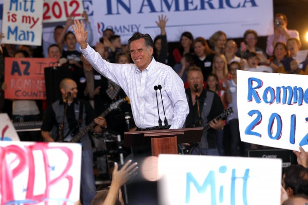 Republican presidential candidate former Massachusetts Gov. Mitt Romney waves at a campaign rally in Mesa, Ariz., Monday, Feb. 13, 2012.