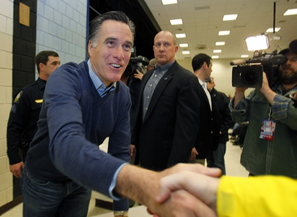 Republican presidential candidate Mitt Romney greets supporters at a caucus, Saturday, Feb. 11, 2012, in Portland.