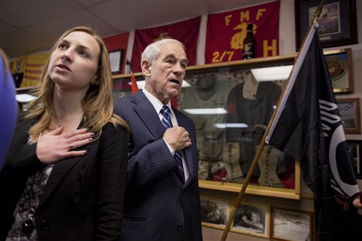 Republican presidential candidate Rep. Ron Paul, R-Texas, right, stands for the Pledge of Allegiance before speaking at a Filipino WW II Veterans gathering, Friday, Feb. 3, 2012, in Las Vegas.