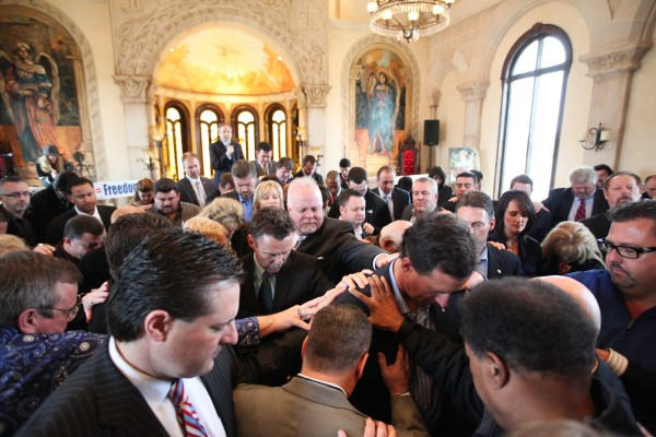 Republican presidential candidate former Pennsylvania Sen. Rick Santorum prays after speaking to pastors during a meeting at Bella Donna Chapel at Adriatica in McKinney, Texas, on Wednesday, Feb.  8, 2012.