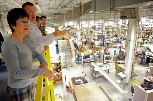 L.L. Bean senior manufacturing manager Jack Samson shows Sen. Susan Collins around the company's Brunswick manufacturing facility Thursday morning, Feb. 23, 2012.