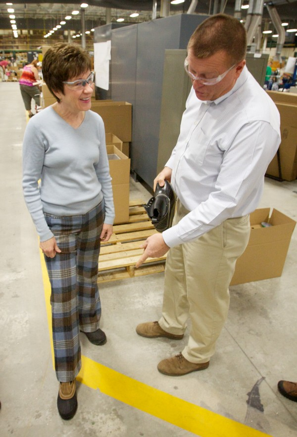 Sen. Susan Collins shows off her L.L. Bean boots while getting a tour from senior manufacturing manager Jack Samson of the Brunswick manufacturing facility —where Bean boots are made Thursday morning, Feb. 23, 2012.