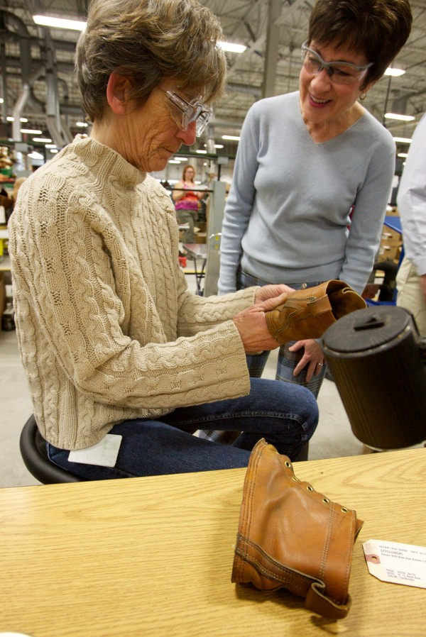 Sen. Susan Collins (right) watches Sharon Willett repair a couple of well-loved L.L. Bean boots at the company's Brunswick manufacturing facility Thursday morning, Feb. 23, 2012.
