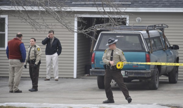 A deputy with the Penobscot County Sheriffs Office cordons the area where Thursday morning shootings took place in Hermon.