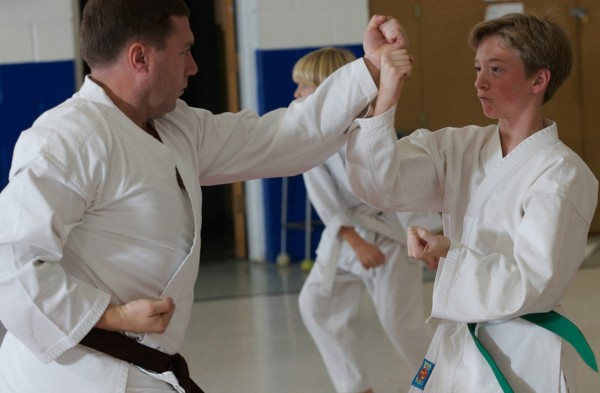 Phippsburg Police Chief and tae kwon do teacher  John Skroski works with Truman Slocum, 12, in a class.