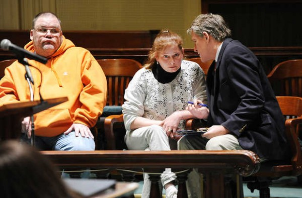 Christopher S. Frazer (left) appears in Androscoggin County Superior Court in Auburn recently for his arraignment on charges of welfare theft.  To his right is Katherine M. Pike, talking with her lawyer, Maurice Porter, after her arraignment on a welfare theft charge.