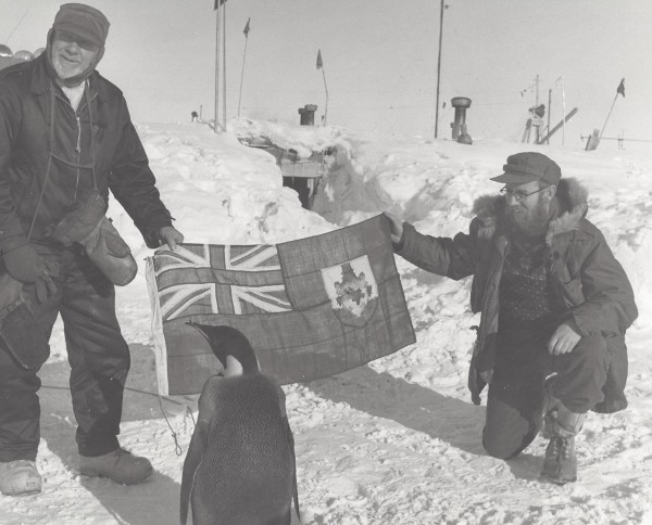 Paul Dalrymple (right) holds an Australian flag with Sir Hubert Wilkins, a polar explorer from Australia, while at the South Pole in 1958.