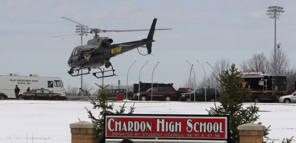 An Ohio State Highway patrol helicopter leaves Chardon High School Monday, Feb. 27, 2012, in Chardon, Ohio. A gunman opened fire inside the high school's cafeteria at the start of the school day Monday, wounding five students, according to officials and local hospitals. A suspect is in custody.