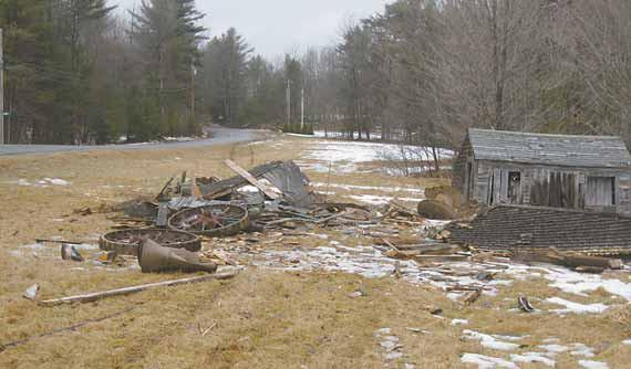 The remnants of a shed can be seen along Lewis Hill Road in Bowdoin on Friday after a pickup truck hit it.