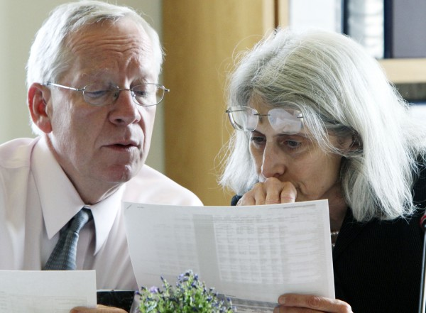 Maine Reps. David Webster, D-Freeport, and Margaret Rotundo, D-Lewiston, pore over documents during a work session at the legislature's Appropriations Committee at the State House in Augusta, Maine, on Monday, June 6, 2011.