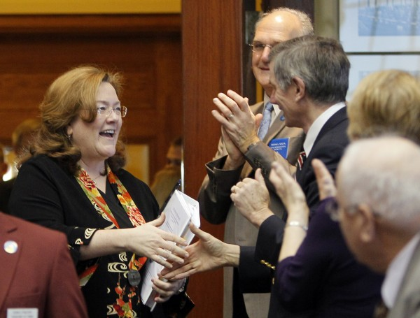 Maine Chief Justice Leigh Saufley (left) is greeted by legislators as she enters the House Chamber to deliver her annual State of the Judiciary address to a joint session of the Legislature on Thursday, Feb. 9, 2012, at the State House in Augusta.