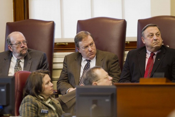 House Majority Leader Robert Nutting, R-Oakland (from left), Maine Senate President Kevin Raye, R-Perry, and Gov. Paul LePage listen to Maine Chief Justice Leigh Saufley's annual State of the Judiciary address on Thursday, Feb. 9, 2012, at the State House in Augusta.