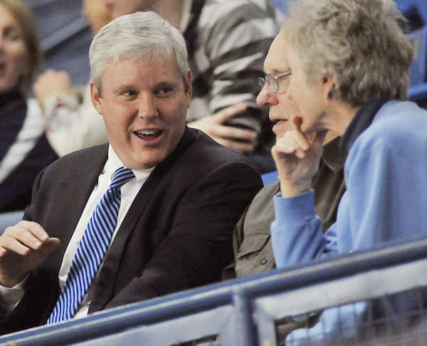 UMaine Athletic Director Steve Abbott talks with his family during the Boston vs. Maine men's basketball game in Orono, Maine, on Jan. 11, 2012.