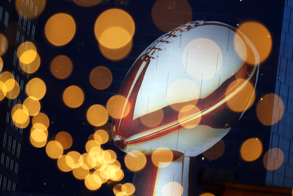 A decal depicting the Vince Lombardi trophy, seen past strands of lights, is displayed on the side of a downtown hotel in Indianapolis, Thursday, Feb. 2, 2012. The New England Patriots face the New York Giants in Super Bowl XLVI on Sunday, Feb. 5.