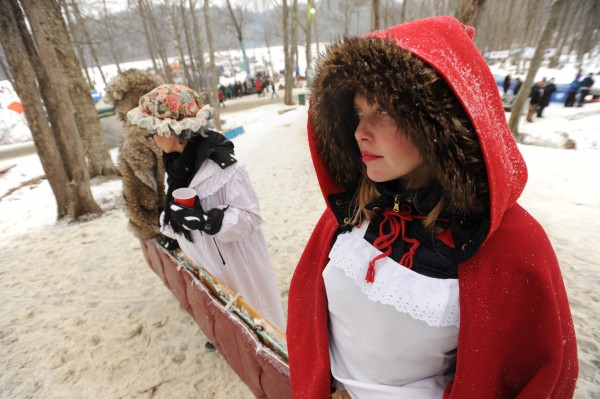 Hillary Neville waits with the rest Boston-based team Little Sled Riding Hood at the base of the wooden stairs leading to the toboggan chute. Neville and her team won best costume for the event.