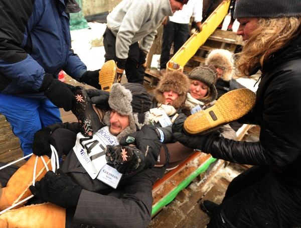 Members of the four-person toboggan team Too Big to Fail get wrapped around each other with a little help from staff members at the 22nd annual U.S. National Toboggan championships on Saturday, Feb 11, 2012 at the Camden Snow Bowl.