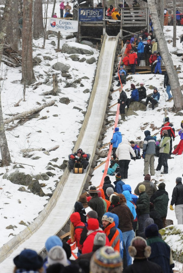 Toboggan racers cover the 400 feet of iced chute in less then 10 seconds.