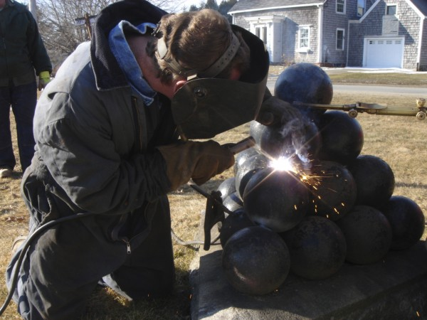 Thomaston Public Works employee Cliff Eugley welds cannon balls together at the GAR Civil War monument at the Thomaston Village Cemetery in Thomaston on Thursday, Feb. 9.