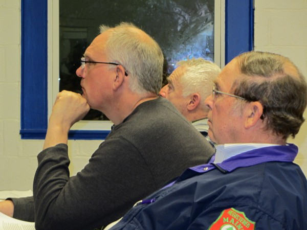 Union Selectmen Lyle Cramer (foreground), Elmer Savage (center) and Appleton Selectmen Chairman Donald Burke listen to a presentation Thursday night, Feb. 23, about ambulance service to their towns.