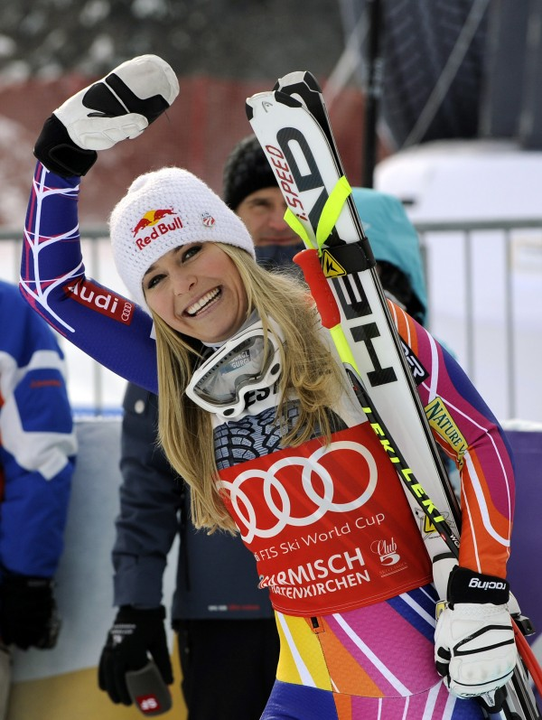 Lindsey Vonn, of the United States, waves as she celebrates after winning an alpine ski, women's World Cup downhill, in Garmisch-Partenkirchen, Germany, Saturday, Feb. 4, 2012. Vonn captured her 50th World Cup career victory by winning the downhill on the demanding Kandahar course on Saturday.