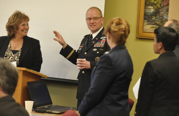 Col. David Sutherland gathers with Maine's First Lady Anne LePage (left), senior military officials and Bangor community before his speech at Husson University on Wednesday, Feb. 22, 2012. Col. Sutherland serves as the Special Assistant to the Chairman of the Joint Chiefs of Staff with a primary focus on Warrior and Family Support.