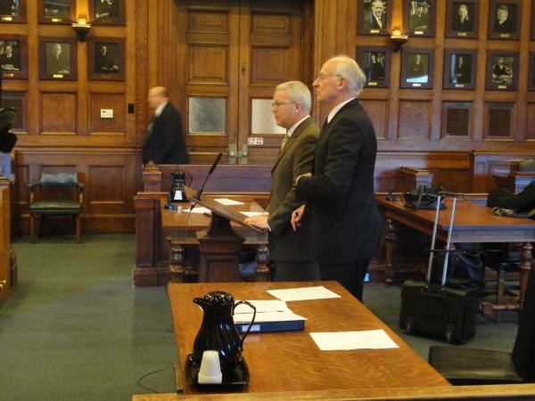 Former Maine Turnpike Authority executive director Paul Violette stands in Cumberland County Superior Court alongside his attorney, Peter DeTroy, Thursday, Feb. 9, 2012. Violette pleaded guilty to theft from his former employer.