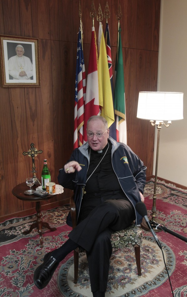 Archbishop of New York, Timothy Dolan, gestures during an interview at the North American College in Rome, Tuesday, Feb. 14, 2012. The top U.S. bishop has vowed legislative and court challenges to President Barack Obama's compromise on exempting religiously affiliated employers from paying directly for birth control for their workers.