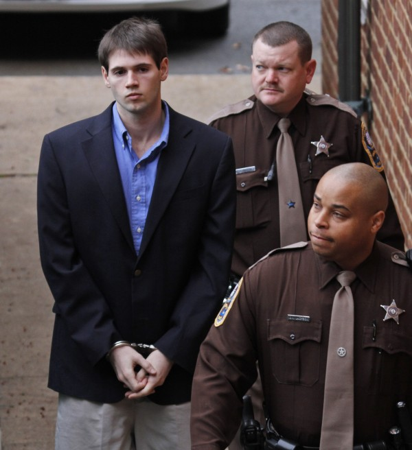 George Huguely V (left) is escorted into the Charlottesville Circuit courthouse in Charlottesville, Va., Wednesday, Feb. 22, 2012.