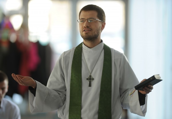 The Reverend Justin Howard preaches to his congregation in Orono on Sunday, Feb. 17, 2012.