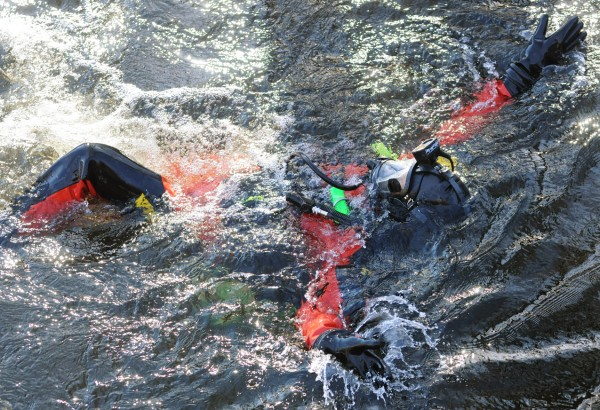 A State Police diver backstrokes to the shore after completing his shift searching the waters of the Messalonskee Stream in Waterville on Friday, Feb. 3, 2012 for Ayla Reynolds who has been missing since Dec. 17, 2011.