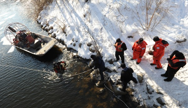 State Police Dive Team Members pull a diver from the water while searching the waters of the Messalonskee Stream for Ayla Reynolds who has been missing since Dec. 17, 2011.