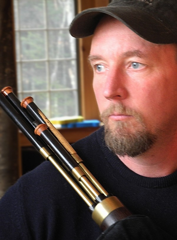 Chris Pinchbeck of Pinchbeck Pipes with a Scottish smallpipe he made at his home in Hope, Maine.