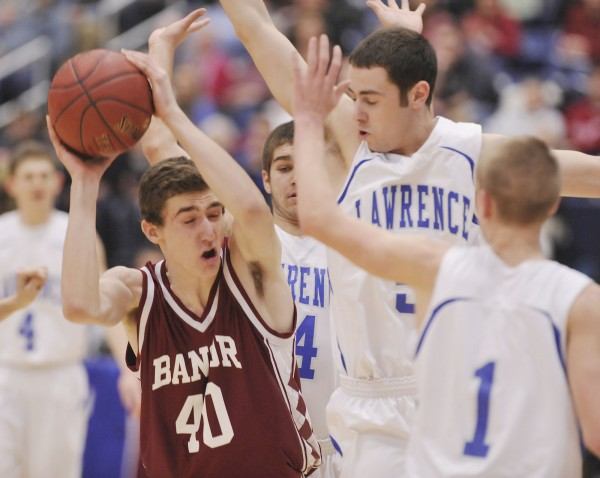 Bangor's Alex Clark (40) gets pressured by Lawrence player Alex Leathers (5) in the Class A playoff game in Augusta on Saturday.
