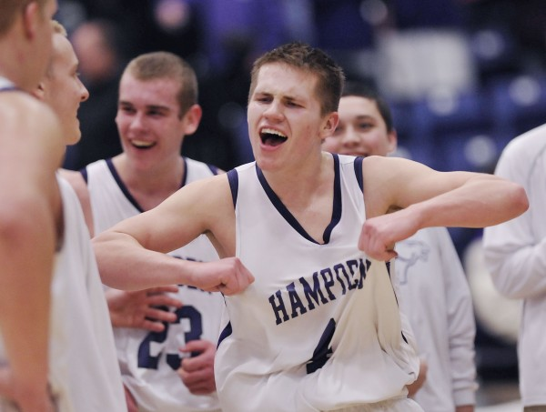 Hampden boys basketball player Chris McCue (4) celebrates with teammates after defeating the Bangor boys team in their Class A playoff game in Augusta on Wednesday, Feb. 22, 2012.