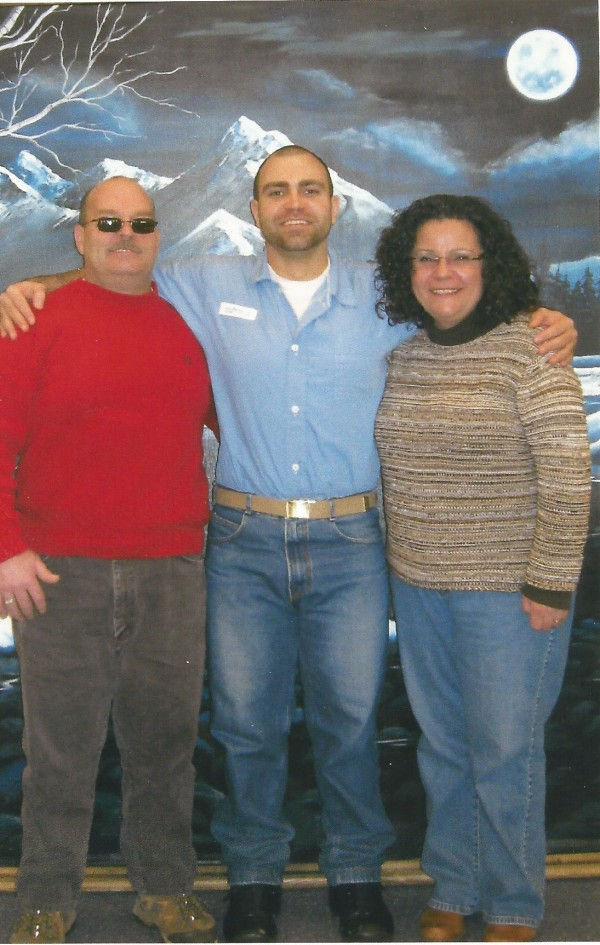 Arty and Pam Belanger stood on either side of their son, Arthur Belanger, in Maine State Prison on Thanksgiving 2011.