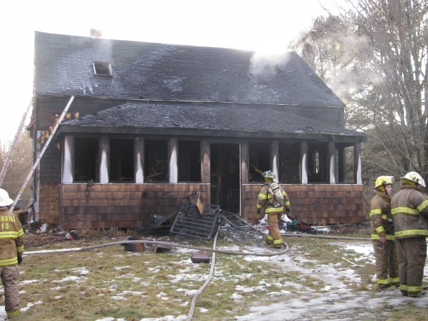 Firefighters from five towns worked Friday afternoon to extinguish a fire that destroyed a West Waldo Road home.
