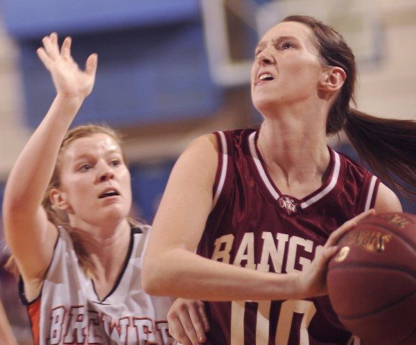 Bangor girls basketball player Katie Brochu (00) drives past Brewer player Deaven Smith (41) in the first half of their game in Bangor, Maine, on Thursday, Feb. 9, 2012.