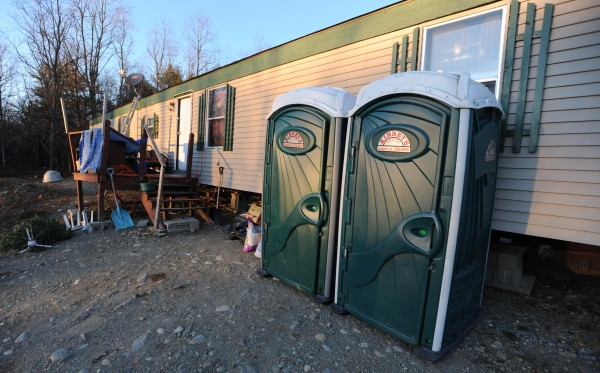 Porta Pottys line the side of a mobile home in Morrill on Thursday, Dec. 29, 2011, where Eleanor Hartshorn and three other family members have sought refuge after their mobile home was destroyed by fire on Wednesday. They join three other family members in a home with no electricity and no running water.