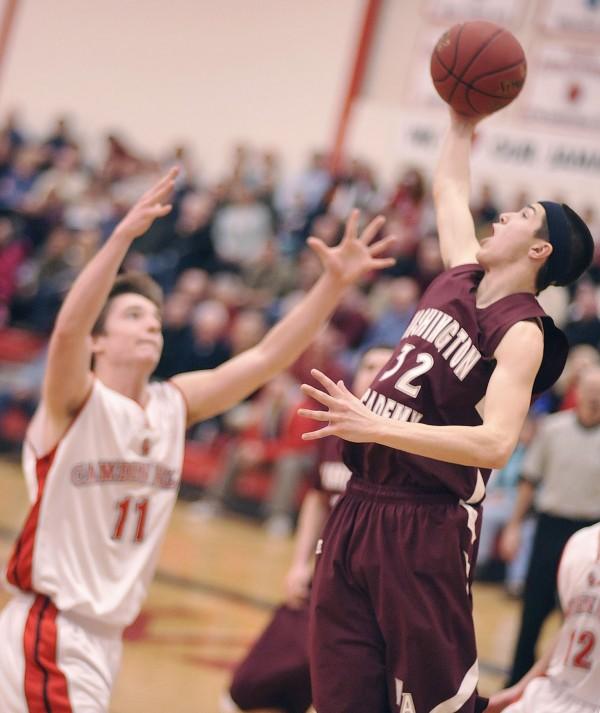 Washington Academy boy's basketbal player Jacob Schoppe (32) collects a second half rebound from Camden Hills' Chandler Crans (11) in Camden, Maine, Wednesday, Feb. 15, 2012.
