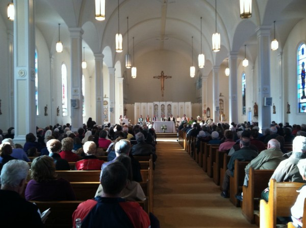 A crowd of nearly 400 look on at the final Mass led by Bishop Richard Malone at the St. Francis de Sales Church in Waterville on Sunday, Feb. 5, 2012.
